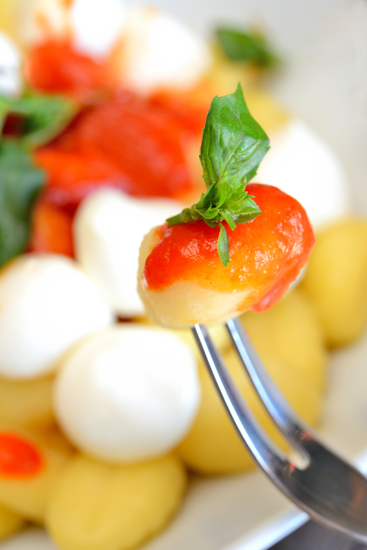 gnocchi flour dumplings with tomato sauce, basil and mozzarella