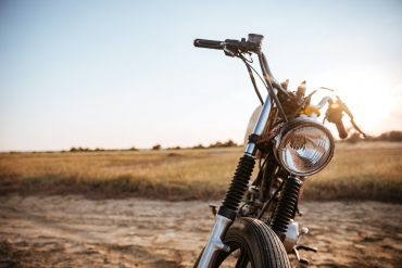 Close-up view on retro motorcycle headlights on the desert background