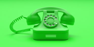 Phone green monochrome concept. Telephone vintage green color on green background. 3d illustration