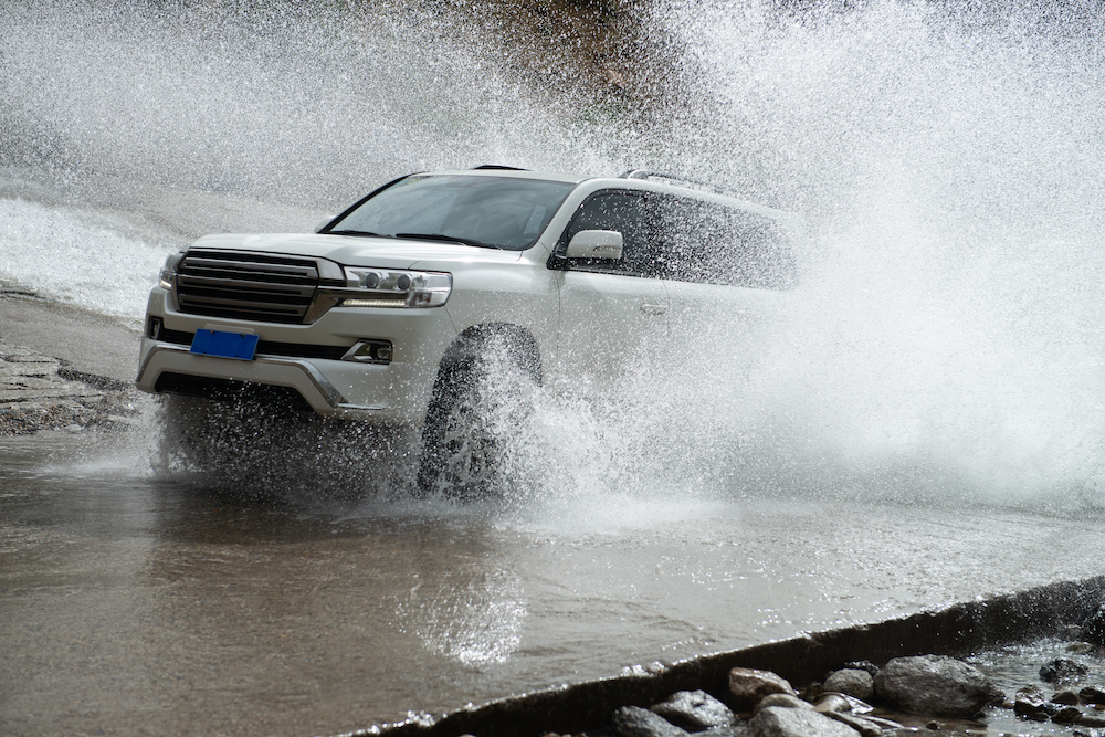 Car tire splashing in water